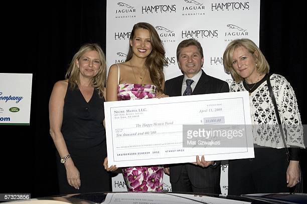 Publisher of Hampton's Magazine Debra Halpert model Petra Nemcova Gary Flom of Jaguar and Niche group publisher Laurie Burgess pose after presenting...