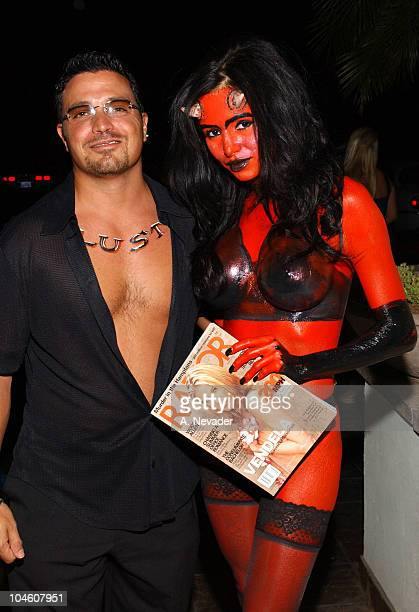 Publisher Richard Botto arriving with Olga Rowe during Razor Magazine's Summer of Swagger Party Seven Deadly Sins at Razor Lounge in Scottsdale...