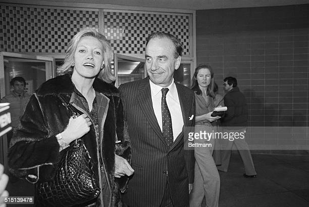 Publisher Rupert Murdoch and his wife Anna leave the Boston Herald American night after the ailing tabloid was taken over by Murdoch earlier