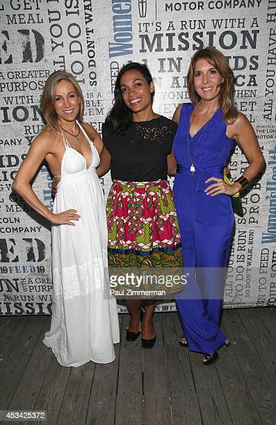 VP publisher Women's Health Magazine Laura FrererSchmidt actress Rosario Dawson and VP EditorinChief Women's Health Magazine Michele Promaulayko...