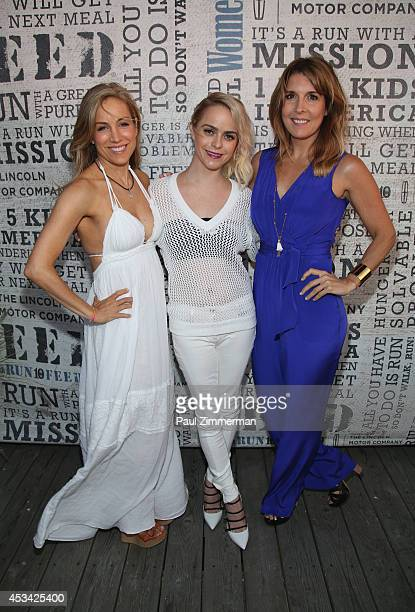 VP publisher Women's Health Magazine Laura FrererSchmidt guest DJ actress Taryn Manning and VP EditorinChief Women's Health Magazine Michele...