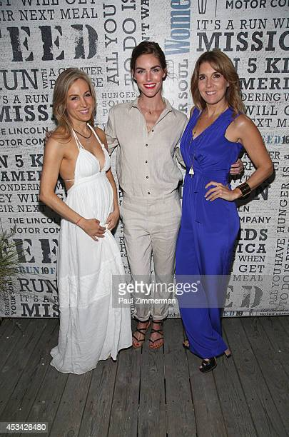 VP publisher Women's Health Magazine Laura FrererSchmidt model Hilary Rhoda and VP EditorinChief Women's Health Magazine Michele Promaulayko attend...
