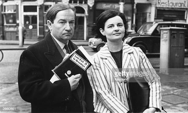 Publishers John Calder and Marion Boyars holding a copy of 'Last Exit to Brooklyn' during a trial to decide whether or not the book contravened the...