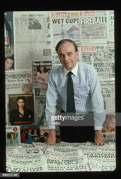 Publishing magnate Rupert Murdoch with sample newspapers and magazines put out by his international conglomerate at the offices of the New York Post...