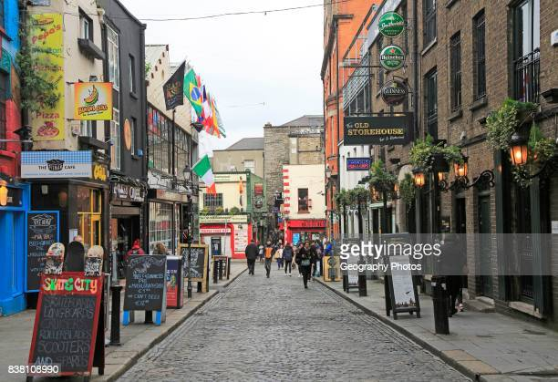 Pubs and restaurants line street in the Temple Bar area Dublin city center Ireland Republic of Ireland