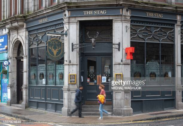 Pubs are closed in Aberdeen, eastern Scotland on August 5 following the announcement that a local lockdown has been imposed on the city after a spike...