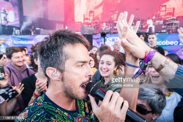 Pucho, singer of Vetusta Morla, performs in the midle of the public of O Son do Camino Festival on June 15, 2019 in Santiago de Compostela, Spain.
