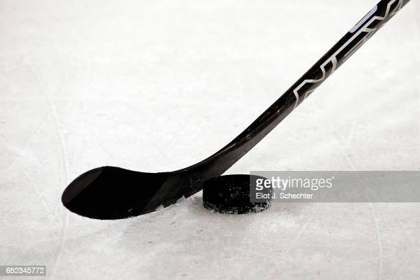A puck and stick at the ready during warm ups between the visiting Minnesota Wild and the Florida Panthers at the BBT Center on March 10 2017 in...
