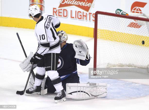 A puck flies in behind Ondrej Pavelev of the Winnipeg Jets as Matt Greene of the Los Angeles Kings gets the first goal of the game in first period...