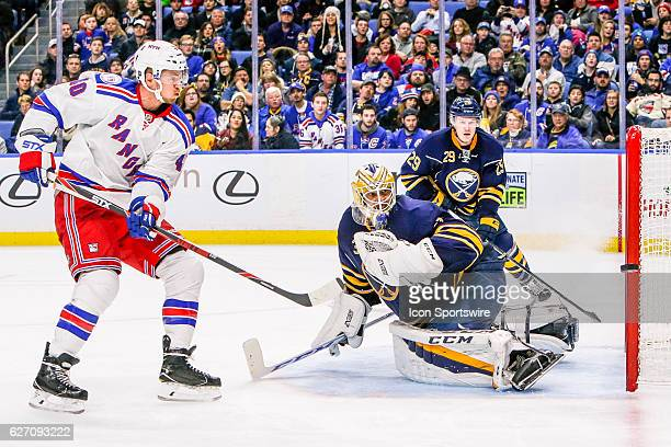 Puck flies past goal post on shot by New York Rangers Left Wing Michael Grabner as Buffalo Sabres Goalie Anders Nilsson and Buffalo Sabres Defenseman...