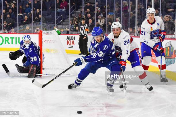 Puck gets away from Syracuse Crunch defenceman Mat Bodie and Laval Rocket center Daniel Audette during the Syracuse Crunch versus the Laval Rocket...