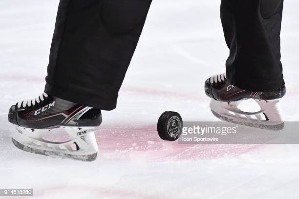 Puck in between linesman skates before face off during the Ottawa Senators versus the Montreal Canadiens game on February 4 at Bell Centre in...