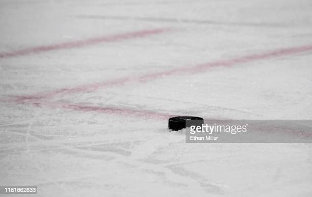 Puck is placed on the ice ahead of a faceoff between the Ottawa Senators and the Vegas Golden Knights during their game at T-Mobile Arena on October...
