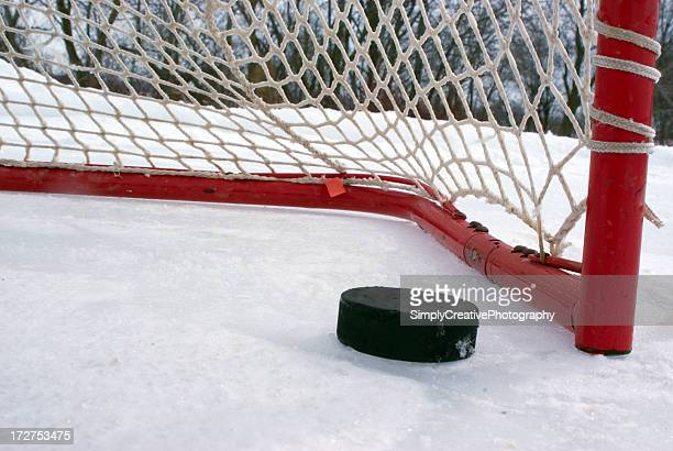 puck on the goal line - hockey puck stock pictures, royalty-free photos & images
