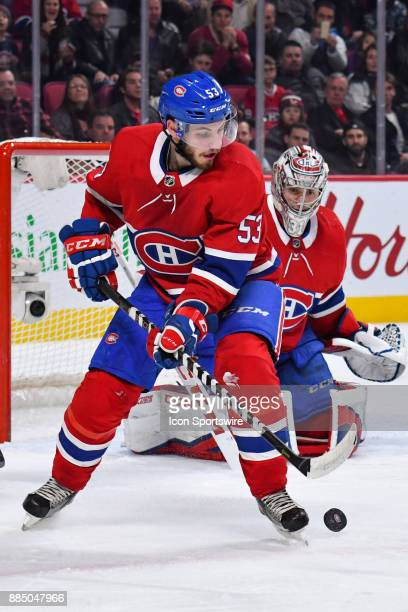 Puck rebounds in front of Montreal Canadiens Defenceman Victor Mete during the Detroit Red Wings versus the Montreal Canadiens game on December 2 at...