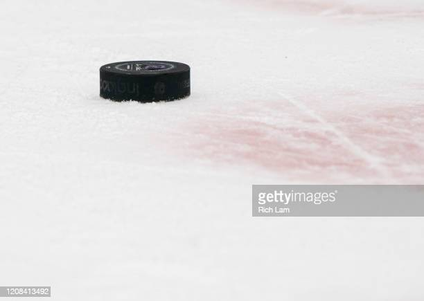 Puck sits on the ice during NHL action between the Vancouver Canucks and the Boston Bruins at Rogers Arena on February 22, 2020 in Vancouver, Canada.