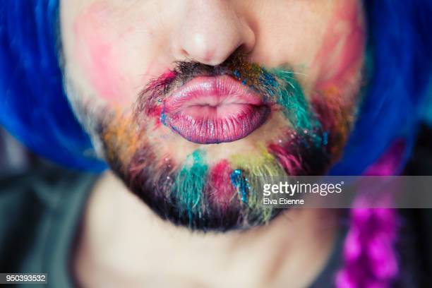 puckering man wearing multicoloured hair chalk through beard, makeup and wig - masculinity stock pictures, royalty-free photos & images