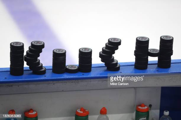 Pucks are stacked on the bench prior to warmups in Game Two of the 2021 NHL Stanley Cup Final between the Tampa Bay Lightning and the Montreal...