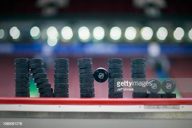 Pucks form the NHL logo as the Vancouver Canucks play the Colorado Avalanche during their NHL game at Rogers Arena November 2 2018 in Vancouver...