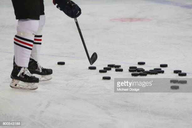 Pucks get used for warm up during the Ice Hockey Classic match between the United States of America and Canada at Hisense Arena on June 24 2017 in...