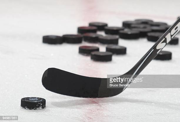 Pucks lie on the ice during warmups prior to the game between the Florida Panthers and the New Jersey Devils at the Prudential Center on December 11,...