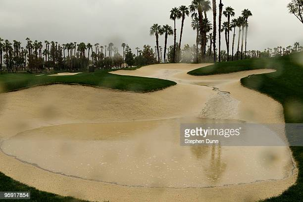 Puddle fills a sand trap on the Palmer Private Course at PGA West before the delayed second round of the Bob Hope Classic on January 21, 2010 in La...