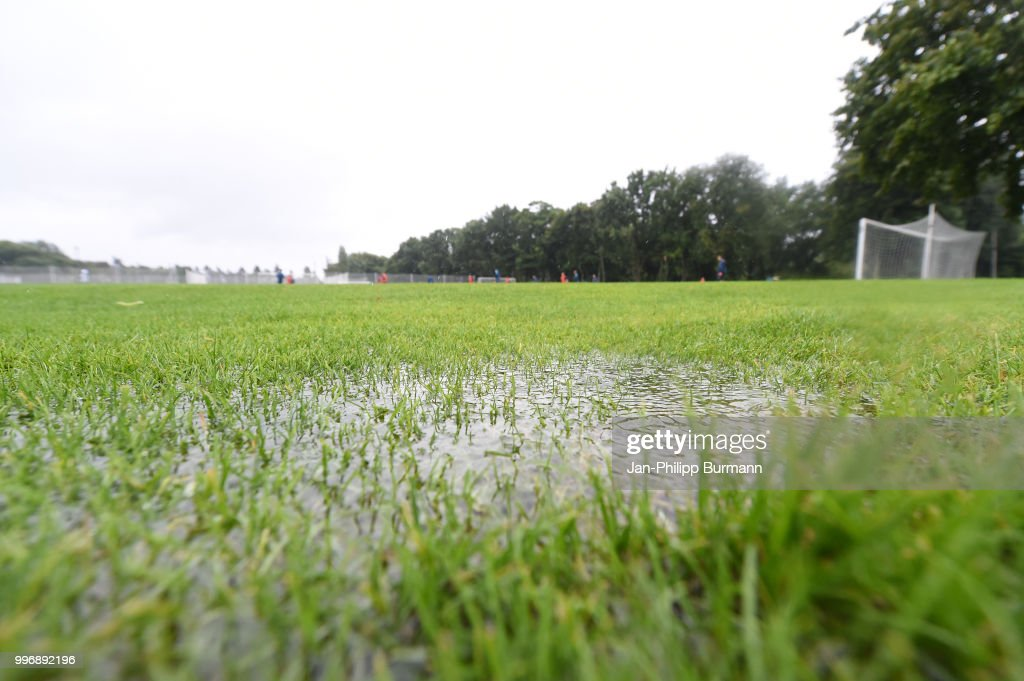 Puddle on the pitch during the training at the Schenkendorfplatz on July 12, 2018 in Berlin, Germany.