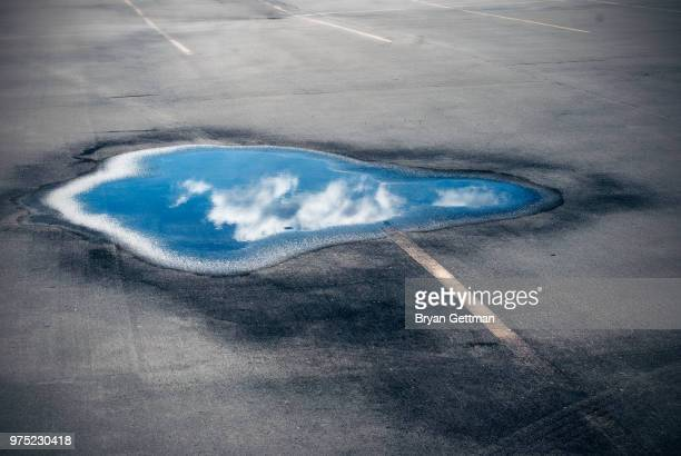 puddle on the road - puddle stock pictures, royalty-free photos & images