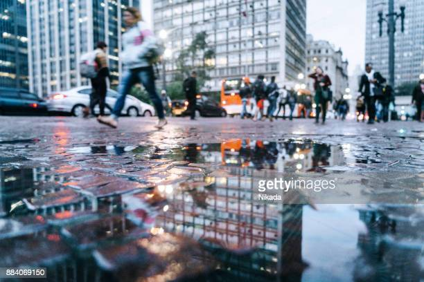 puddle reflection view to the streets of downtown são paulo, brazil - puddle stock pictures, royalty-free photos & images