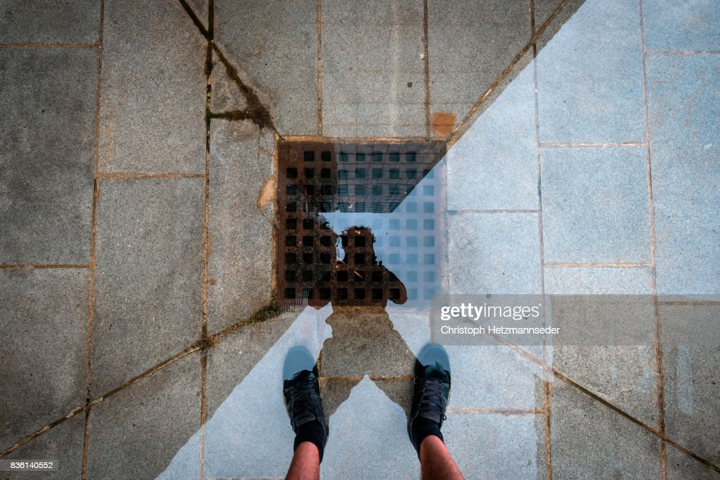 Puddle self portrait : Stock Photo