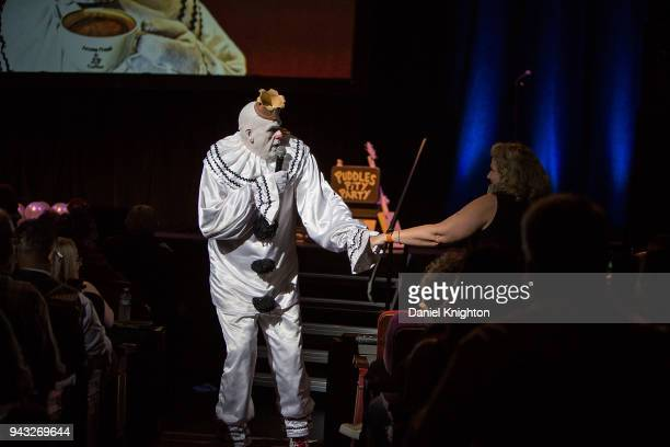 Puddles Pity Party pulls audience member Lori Kaplan out of the crowd to join him on stage at Balboa Theatre on April 7 2018 in San Diego California