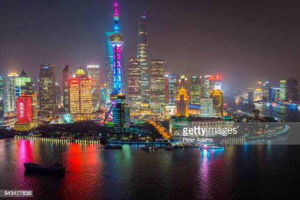 pudong financial skyline and huangpu river at night, shanghai, china - pudong stock pictures, royalty-free photos & images