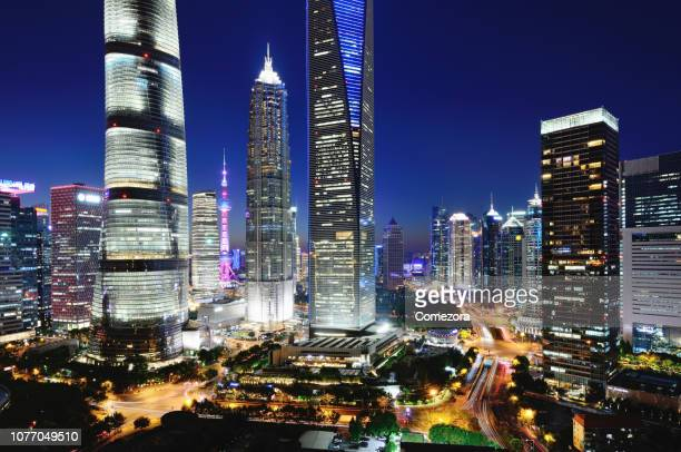 pudong lujiazui financial district at night, shanghai, china - lujiazui stock photos and pictures