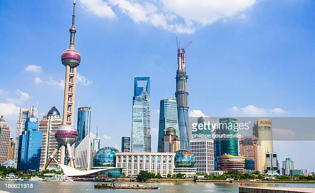 CONTENT] pudong under blue sky and sunshine Skycrapers during summer