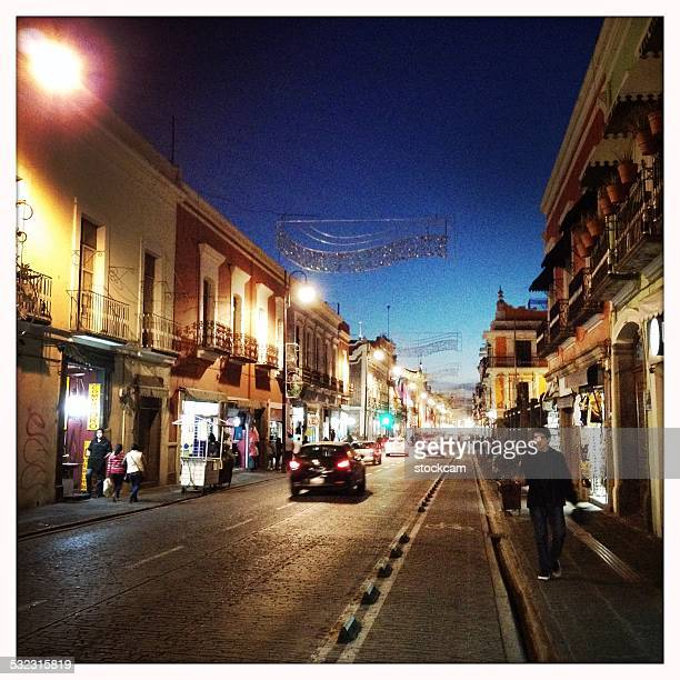 puebla street at dusk, mexico - puebla mexico stock pictures, royalty-free photos & images