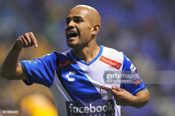 Puebla's Francisco Acuna celebrates after scoring against Tigres during their Mexican Clausura tournament football match at Cuauhtemoc stadium on...