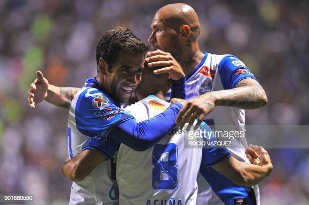 Puebla's Francisco Acuna celebrates with teammates after scoring against Tigres during their Mexican Clausura tournament football match at Cuauhtemoc...