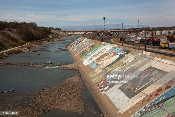 Pueblo Arkansas River levee murals with trains Colorado Rocky Mountains