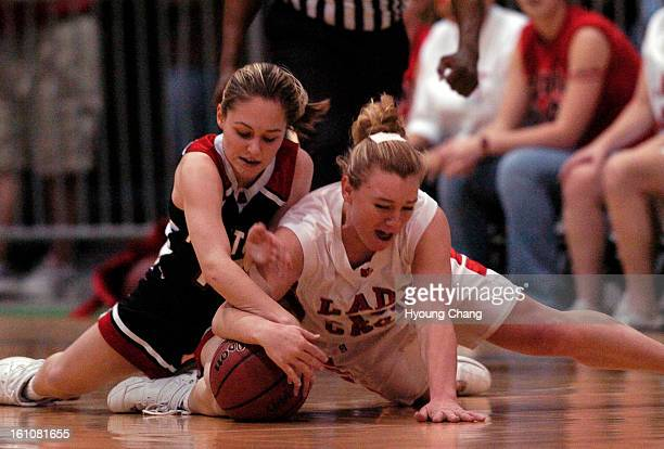 Pueblo CO March 11 2006 McClave's Josie Mallard right steals the ball from Haxtun's Mallory Green during the 1st quater of Championship game at...