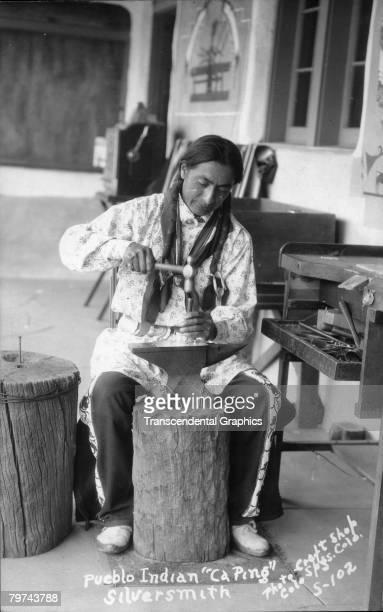 Pueblo Indian silversmith CaPing works in his craft shop in Colorado Springs Colorado ca 1930