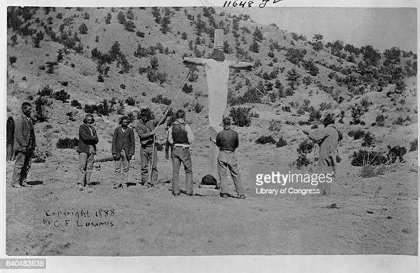 Pueblo Indians errect a crude crucifix in the desert New Mexico ca 18881890