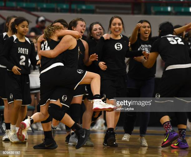 Pueblo South Brooke Crowell gets a hug from Britt Brown after defeating Mesa Ridge in overtime 7462 during the SemiFinal of the 2018 State Basketball...