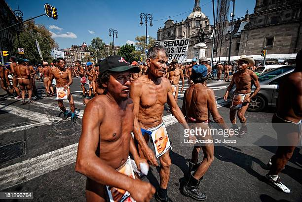 Pueblos protest in the nude against governmental policies that put their land rights in jeopardy in the State of Veracruz In this image they are at...