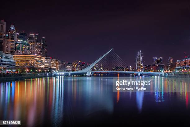 puente de la mujer over river in city at night - buenos aires stock pictures, royalty-free photos & images