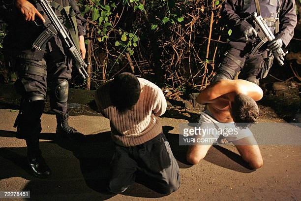 Police Reaction Group officers guard Jorge Navarro aka 'The Sleeper' and Oscar Navarro aka 'The Jokers' alleged members of Mara Salvatrucha gang who...