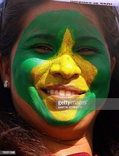 A Brazilians supporter shows her face painted with her national flag before the Copa America Venezuela2007 tournament football match Brazil vs...