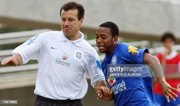 Puerto La Cruz, VENEZUELA: Brazilian coach Dunga vies for the ball with Robinho during a training sesion in Puerto La Cruz, Venezuela, 24 June 2007....