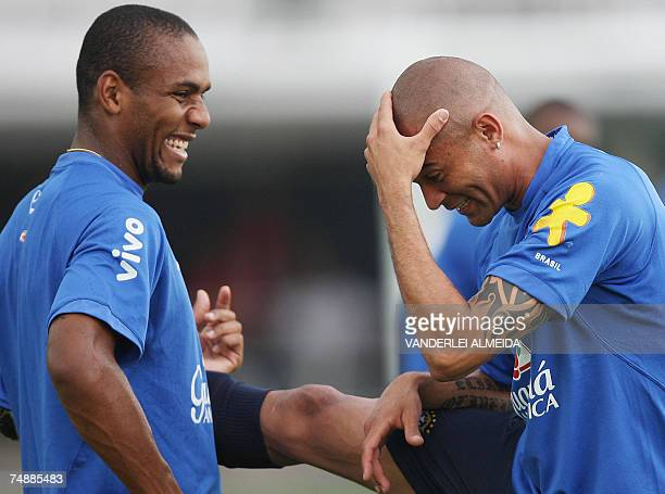 Brazilian footballers Maicon and Afonso laugh during a training session in Puerto La Cruz Venezuela 25 June 2007 in the eve of the launching of the...