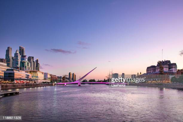 puerto madero in buenos aires at dusk - puente de la mujer stock pictures, royalty-free photos & images