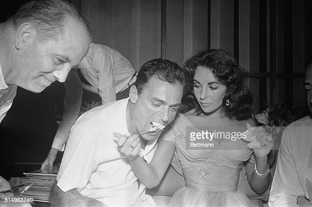 Cake For The Bride Mike Todd feeds his lovely bride Elizabeth Taylor some wedding cake after their marriage in Puerto Marques February 2nd The couple...